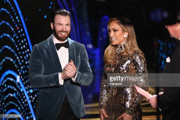In this handout provided by AMPAS Chris Evans and Jennifer Lopez pose backstage during the 91st Annual Academy Awards at the Dolby Theatre on...