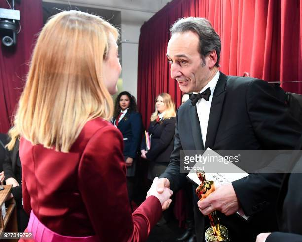 In this handout provided by AMPAS composer Alexandre Desplat winner of the Best Original Score award for 'The Shape of Water' attends the 90th Annual...