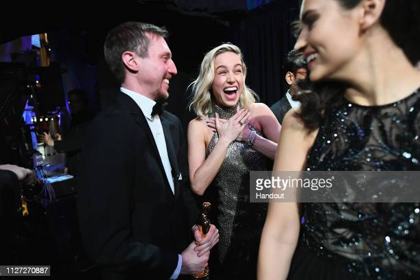In this handout provided by AMPAS David Rabinowitz poses with the Best Adapted Screenplay award for 'BlacKkKlansman' with presenter Brie Larson...