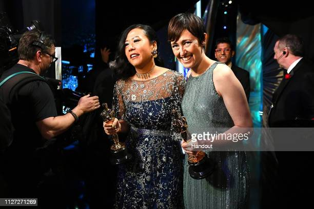 In this handout provided by AMPAS Domee Shi and Becky NeimanCobb winners of Best Animated Short Film for 'Bao' pose backstage during the 91st Annual...