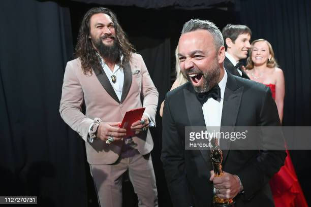 In this handout provided by AMPAS Evan Hayes reacts backstage after winning the Best Documentary Feature award for Free Solo as presenter Jason Momoa...