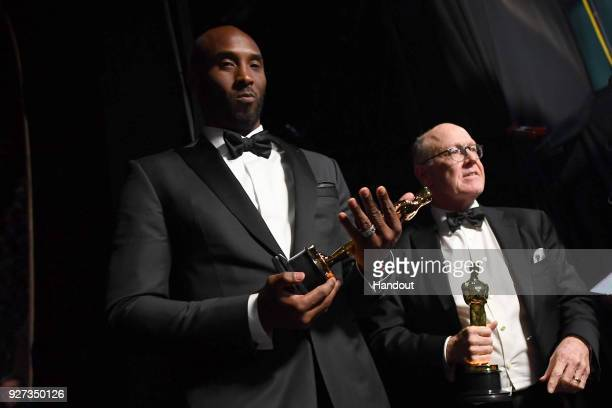 In this handout provided by A.M.P.A.S., filmmakers Kobe Bryant and Glen Keane, winners of the Best Animated Short Film award for 'Dear Basketball,'...