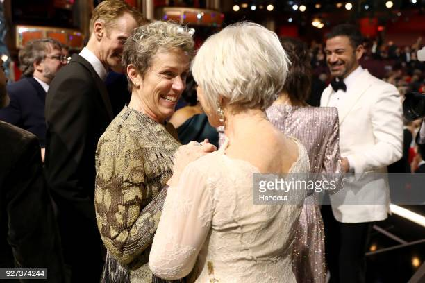 In this handout provided by AMPAS Frances McDormand and Helen Mirren attend the 90th Annual Academy Awards at the Dolby Theatre on March 4 2018 in...