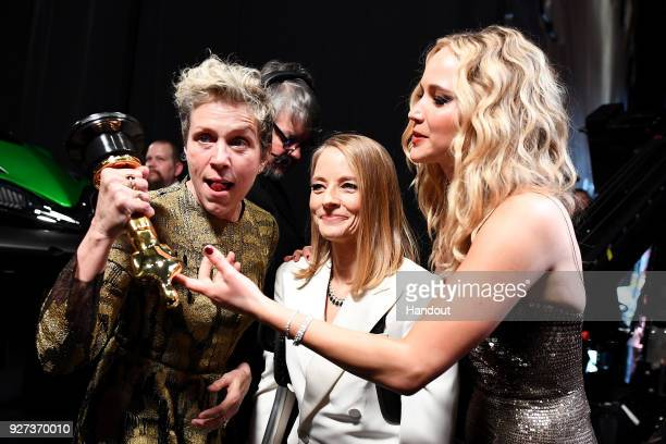 In this handout provided by AMPAS Frances McDormand Jodie Foster and Jennifer Lawrence attend the 90th Annual Academy Awards at the Dolby Theatre on...