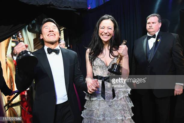 In this handout provided by AMPAS Free Solo filmmakers Jimmy Chin and Elizabeth Chai Vasarhelyi pose with awards backstage during the 91st Annual...