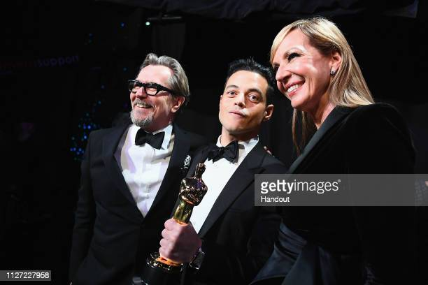 In this handout provided by AMPAS Gary Oldman Best Actor in a Leading Role for 'Bohemian Rhapsody' Rami Malek and Allison Janney pose backstage...