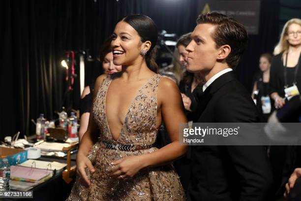In this handout provided by AMPAS Gina Rodriguez and Tom Holland attend the 90th Annual Academy Awards at the Dolby Theatre on March 4 2018 in...