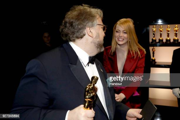 In this handout provided by AMPAS Guillermo del Toro winner of the Best Director and Best Picture awards for 'The Shape of Water' and Emma Stone...