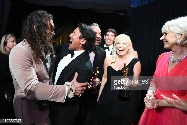 In this handout provided by AMPAS Jason Momoa Jimmy Chin Evan Hayes Alex Honnold Shannon Dill and Helen Mirren backstage during the 91st Annual...