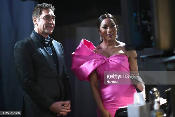 In this handout provided by AMPAS Javier Bardem and Angela Bassett pose backstage during the 91st Annual Academy Awards at the Dolby Theatre on...