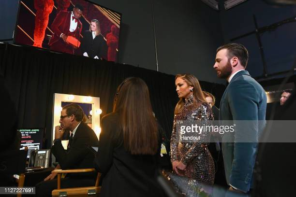 In this handout provided by AMPAS Jennifer Lopez and Chris Evans pose backstage during the 91st Annual Academy Awards at the Dolby Theatre on...