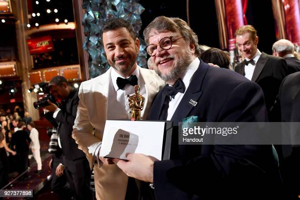 In this handout provided by AMPAS Jimmy Kimmel and Guillermo del Toro attend the 90th Annual Academy Awards at the Dolby Theatre on March 4 2018 in...