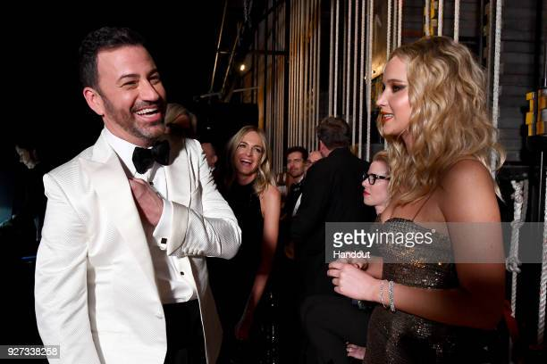 In this handout provided by AMPAS Jimmy Kimmel and Jennifer Lawrence attend the 90th Annual Academy Awards at the Dolby Theatre on March 4 2018 in...
