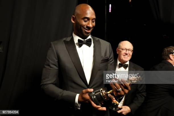 In this handout provided by A.M.P.A.S., Kobe Bryant, winner of the Best Animated Short Film award for 'Dear Basketball,' attends the 90th Annual...