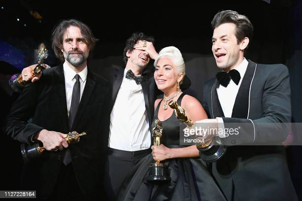 In this handout provided by AMPAS Lady Gaga Mark Ronson Anthony Rossomando Andrew Wyatt and Benjamin Rice pose with the Music award for 'Shallow'...