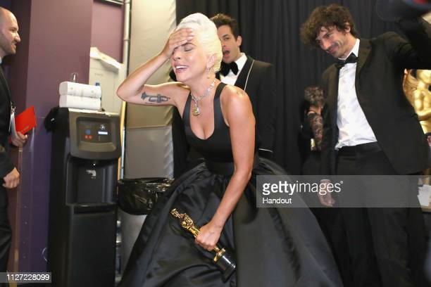 In this handout provided by AMPAS Lady Gaga poses with the Music award for 'Shallow' from 'A Star Is Born' backstage during the 91st Annual Academy...
