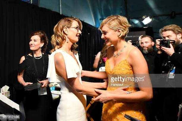 In this handout provided by AMPAS Laura Dern and Greta Gerwig at the 90th Annual Academy Awards at the Dolby Theatre on March 4 2018 in Hollywood...