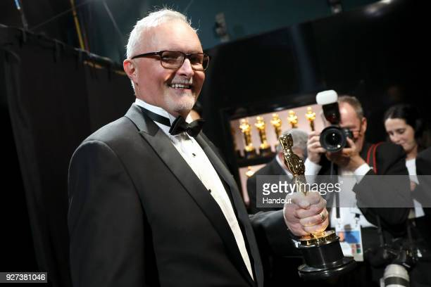 In this handout provided by AMPAS Lee Smith winner of Best Film Editing award for 'Dunkirk' attends the 90th Annual Academy Awards at the Dolby...