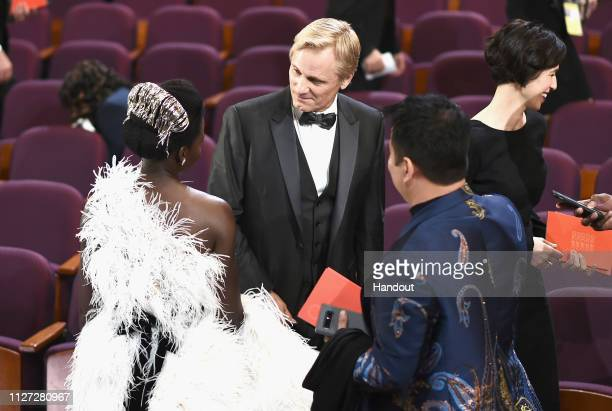 In this handout provided by AMPAS Lupita Nyong'o Viggo Mortensen and Ariadna Gil attend the 91st Annual Academy Awards at the Dolby Theatre on...