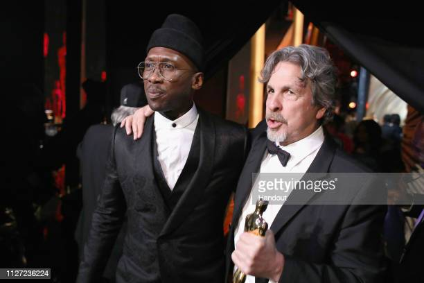In this handout provided by AMPAS Mahershala Ali and Peter Farrelly pose with the Best Picture award for 'Green Book' backstage during the 91st...
