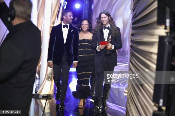 In this handout provided by AMPAS Michael B Jordan and Tessa Thompson walk off stage after presenting the Best Original Score award for 'Black...
