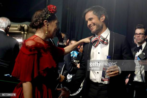 In this handout provided by AMPAS Natalia Lafourcade and Gael Garcia Bernal attend the 90th Annual Academy Awards at the Dolby Theatre on March 4...
