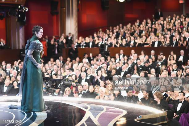 In this handout provided by AMPAS Olivia Colman accepts the Actress in a Leading Role award for 'The Favourite' onstage during the 91st Annual...