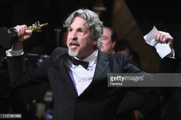 In this handout provided by AMPAS Peter Farrelly poses with the Best Picture and Best Original Screenplay award for 'Green Book' backstage during the...