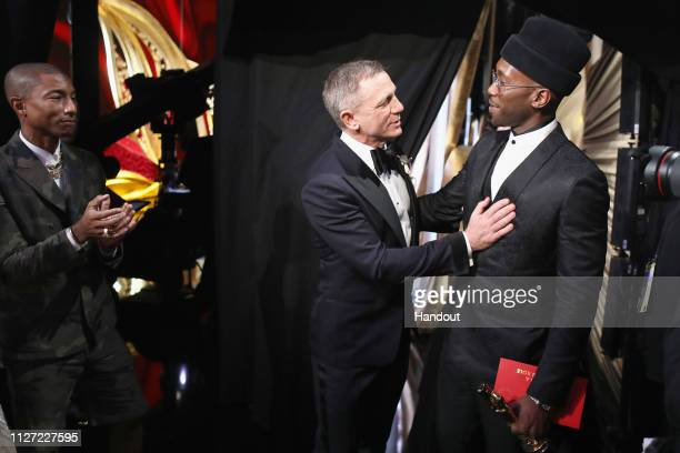 In this handout provided by A.M.P.A.S., Pharrell Williams, Daniel Craig, and Best Actor in a Supporting Role winner Mahershala Ali pose backstage...