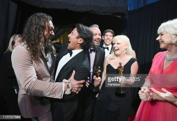 In this handout provided by AMPAS presenter Jason Momoa poses with Best Documentary Feature winners for Free Solo Jimmy Chin Evan Hayes Alex Honnold...