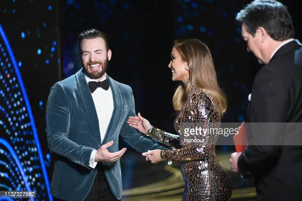 In this handout provided by AMPAS presenters Chris Evans and Jennifer Lopez pose backstage during the 91st Annual Academy Awards at the Dolby Theatre...