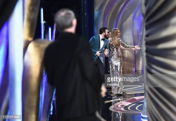 In this handout provided by AMPAS presenters Chris Evans and Jennifer Lopez walk onstage during the 91st Annual Academy Awards at the Dolby Theatre...