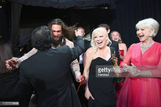 In this handout provided by AMPAS Presenters Jason Momoa and Helen Mirren react backstage with director Jimmy Chin and producer Shannon Dill after...