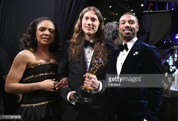 In this handout provided by AMPAS Presenters Tessa Thompson and Michael B Jordan pose backstage after presenting the Best Original Score award for...