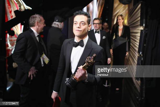 In this handout provided by AMPAS Rami Malek poses with the Actor in a Leading Role award for 'Bohemian Rhapsody' backstage during the 91st Annual...