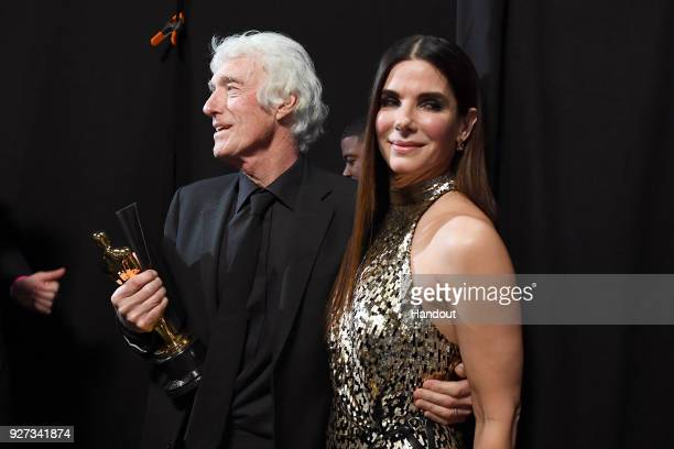 In this handout provided by AMPAS Roger A Deakins winner Best Cinematography for 'Blade Runner 2049'and Sandra Bullock attend the 90th Annual Academy...