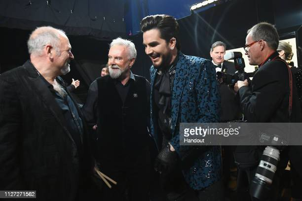 In this handout provided by AMPAS Roger Taylor of Queen and Adam Lambert pose backstage with Spike Edney during the 91st Annual Academy Awards at the...