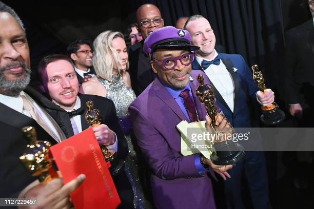 In this handout provided by AMPAS Spike Lee Charlie Wachtel David Rabinowitz and Kevin Willmott pose with the Best Adapted Screenplay award for...