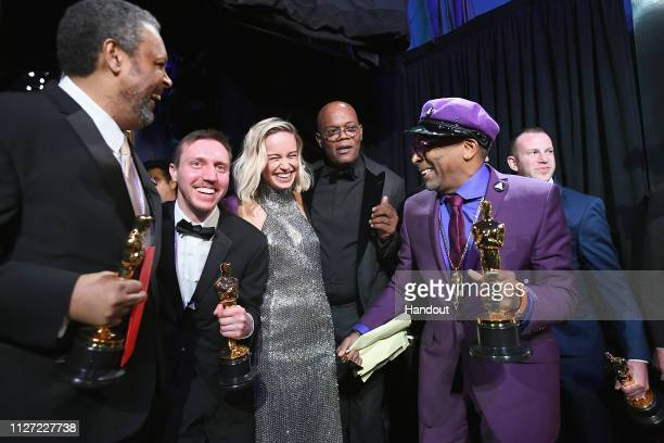 In this handout provided by AMPAS Spike Lee David Rabinowitz Kevin Willmott and Charlie Wachtel pose with the Adapted Screenplay award for...