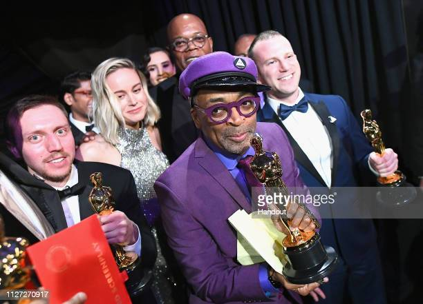 In this handout provided by A.M.P.A.S., Spike Lee, David Rabinowitz, Kevin Willmott and Charlie Wachtel pose with the Adapted Screenplay award for...