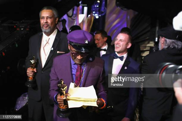 In this handout provided by A.M.P.A.S., Spike Lee, Kevin Willmott and Charlie Wachtel pose with the Adapted Screenplay award for 'BlacKkKlansman'...