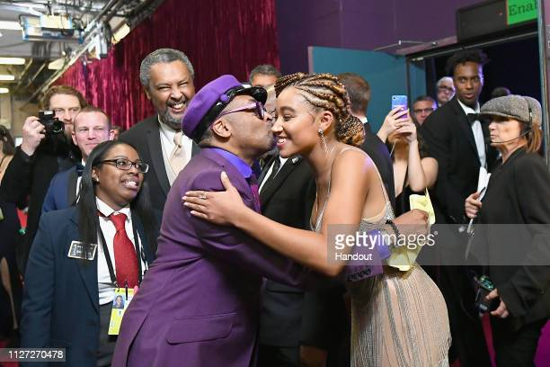 In this handout provided by AMPAS Spike Lee poses with the Best Adapted Screenplay award for 'BlacKkKlansman' with presenter Amandla Stenberg...