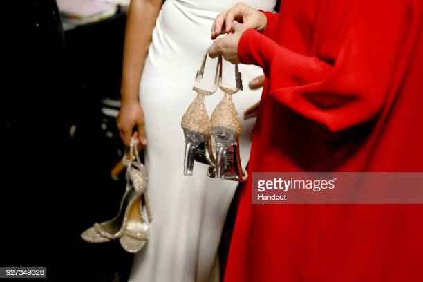 In this handout provided by AMPAS Tiffany Haddish and Maya Rudolph shoe detail attend the 90th Annual Academy Awards at the Dolby Theatre on March 4...