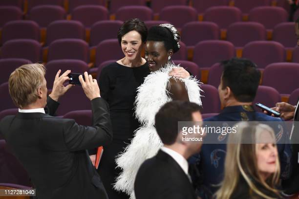In this handout provided by AMPAS Viggo Mortensen takes a photo of Ariadna Gil and Lupita Nyong'o after the 91st Annual Academy Awards at the Dolby...