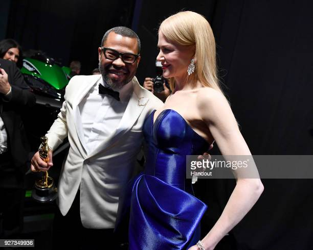 In this handout provided by AMPAS writer Jordan Peele winner of the Best Original Screenplay award for 'Get Out' and actor Nicole Kidman attend the...
