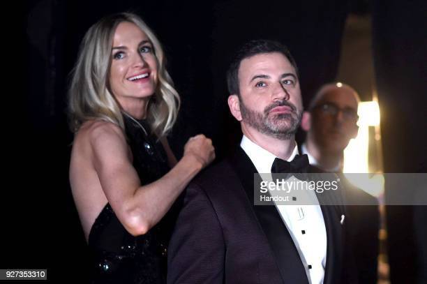 In this handout provided by AMPAS writer Molly McNearney and host Jimmy Kimmel attend the 90th Annual Academy Awards at the Dolby Theatre on March 4...