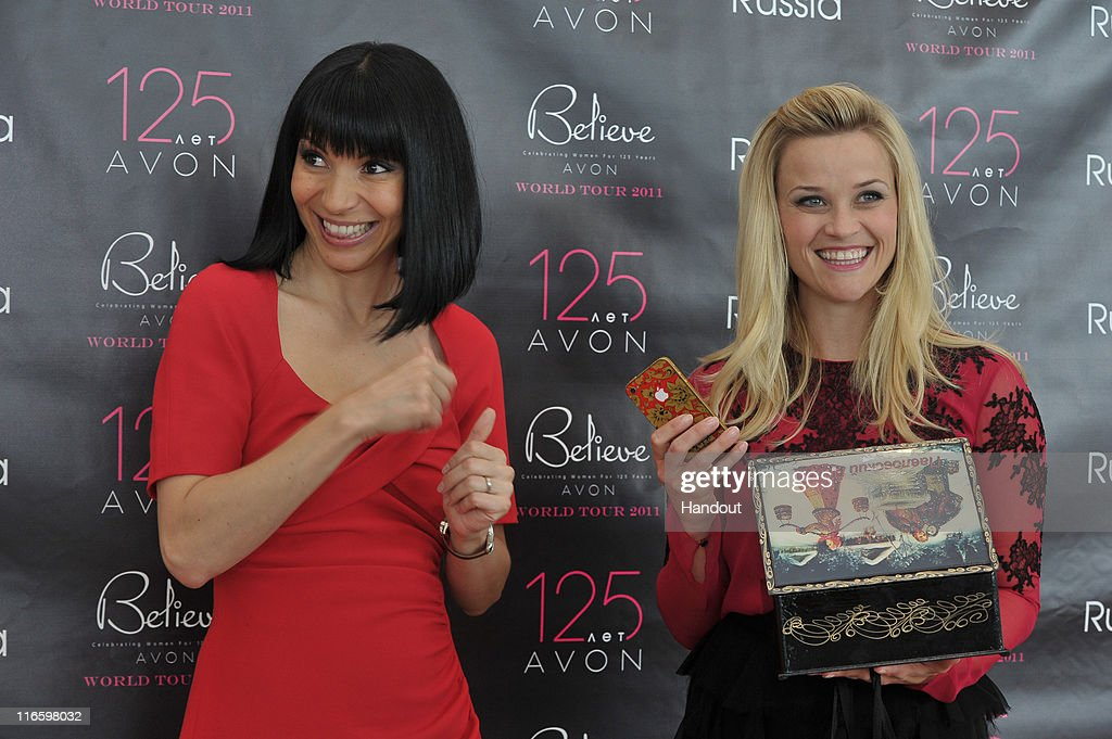 In this handout provided by Avon, Avon Global Ambassador Reese Witherspoon receives a welcome gift on her first visit to Russia from Avon General Manager Angela Cretu at the Avon Believe World Tour on June 16, 2011 in Moscow, Russia.