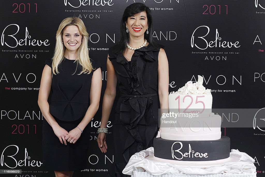 In this handout provided by Avon, Avon Global Ambassador Reese Witherspoon and Avon Chairman & CEO Andrea Jung attend the Avon Believe World Tour on June 14, 2011 in Warsaw, Poland.