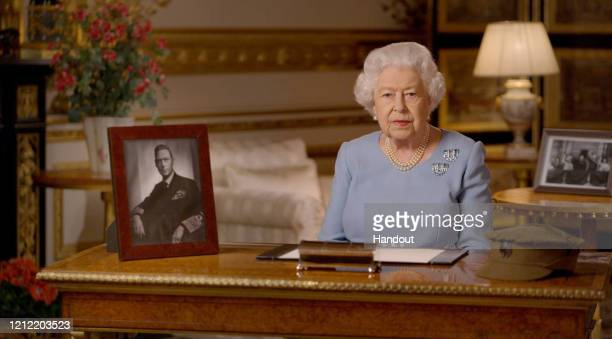 In this handout provided by Buckingham Palace Queen Elizabeth II addresses the nation and the Commonwealth on the 75th anniversary of VE Day at...