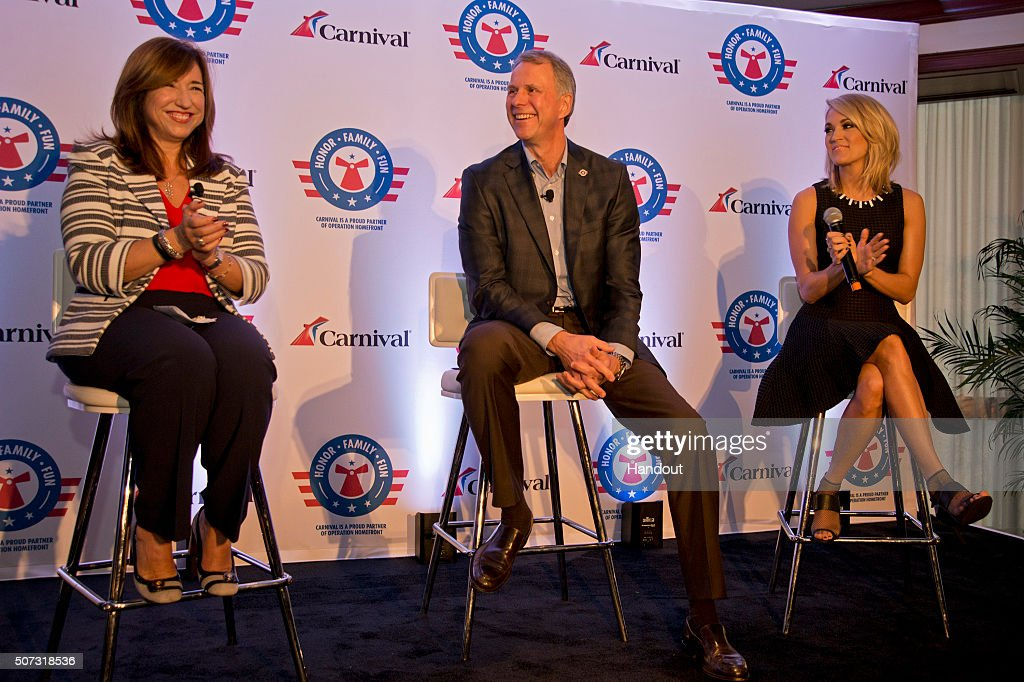 In this handout provided by Carnival Cruise Line, Christine Duffy, president of Carnival Cruise Line; Brig. Gen. John Pray, president and CEO of Operation Homefront, and country music artist Carrie Underwood finish up a news conference Thursday, Jan. 28, 2016, in Jacksonville, Fla., to announce a new initiative to support U.S. military families. The effort between the three entities is to raise funds through a series of projects during Underwood's concert tour and aboard Carnival's ships as well as the company's website. FOR